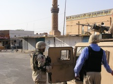 Visiting Samarra to inspect post-combat reconstruction efforts, either October or November 2004. Note the camera in my left hand. Myself, US Army and Iraqi engineers would diligently photograph our work to document progress, account for expenditures, and illustrate/illuminate a victory narrative for the American command in Baghdad and politicians in Washington, DC. Of course, pictures will not explain the fear, anger and desperation of a people that feel usurped, occupied, displaced and living under existential threat from foreigners, religious extremists, and rivals within their own society, such as the Shia dominated government.